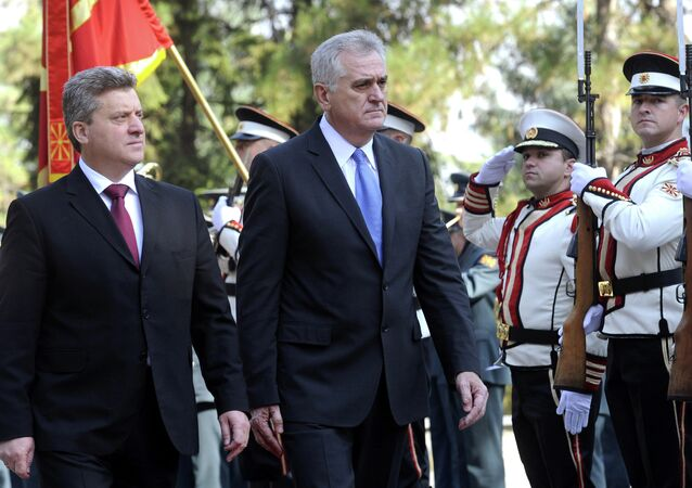 Serbia's President Tomislav Nikolic, center, is welcomed by his Macedonian counterpart Gjorge Ivanov, left, upon his arrival at Macedonia's capital Skopje, on Friday, Oct. 26, 2012