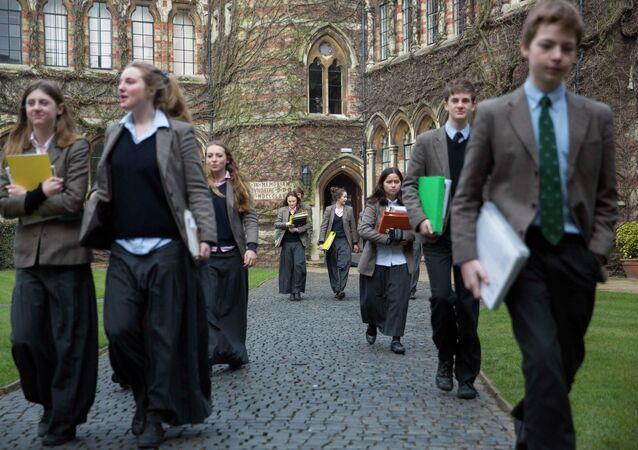 Pupils walk to lessons at Rugby School in central England, March 18, 2015