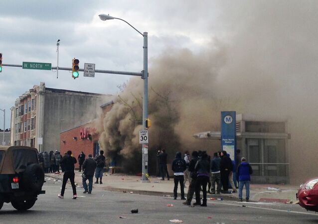 Smoke billows from a CVS Pharmacy store in Baltimore on Monday, April 27, 2015