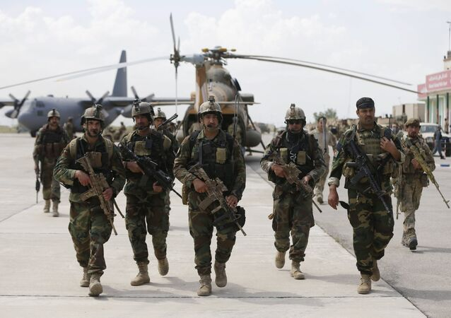 Afghan security forces arrive at the Kunduz airport, April 30, 2015.