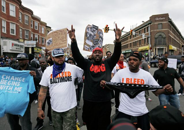 A man who calls himself Goldie Loc, center left, walks with a man who calls himself Wolfe, center, right, celebrating on Friday, May 1, 2015.