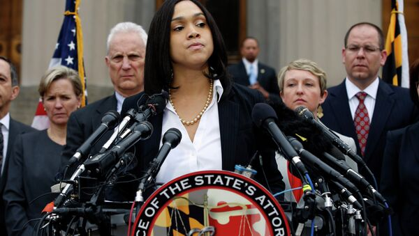 Marilyn Mosby, Baltimore state's attorney, pauses while announcing charges against the six officers involved in Gray's arrest, on Friday, May 1, 2015 in Baltimore. - Sputnik International