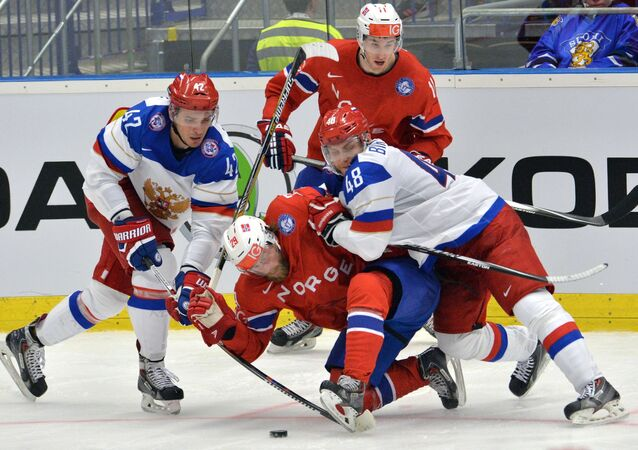 The player of the Russian hockey team Artem Anisimov, Norwegian hockey players Robin Dahlstrom, Andreas Stene, Russian hockey player Evgeny Biryukov during the hockey match, April 2, 2015