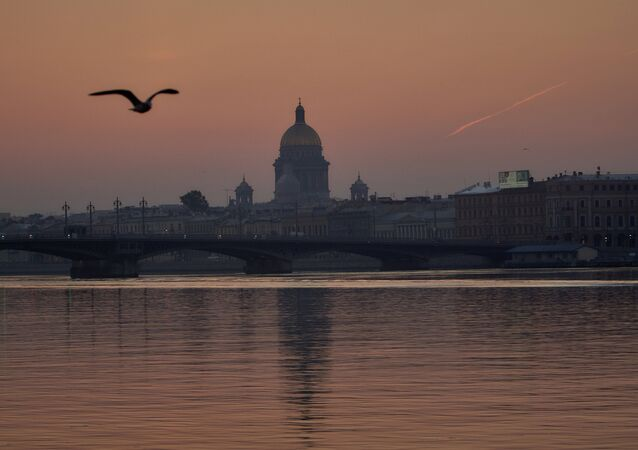 A view of the Blagoveshchensky (Annunciation) Bridge and St. Isaac's Cathedral at dawn in St. Petersburg.