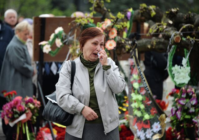 A woman cries during a gatherin in front of the Trade Union House in Odessa, southern Ukraine, on May 2, 2015, in memory of people who died in a fire at the Trade Union House in May 2014
