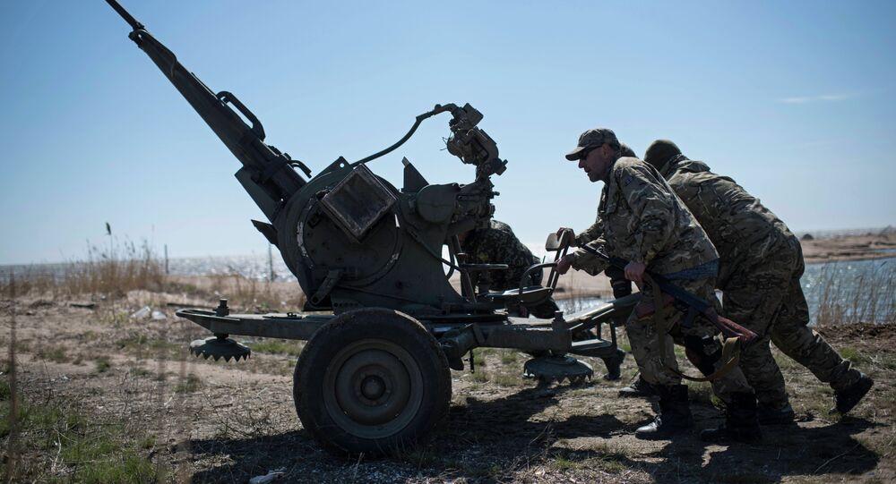 Ukrainian servicemen deploy a weapon at the beach of the Azov Sea in Shyrokyne, eastern Ukraine