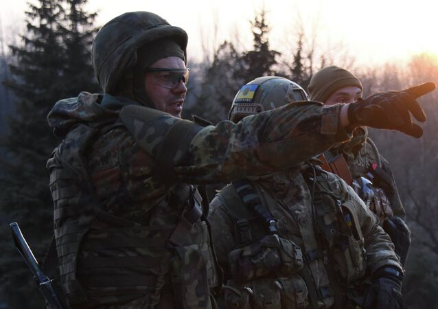 Fighters of the Azov Battalion observe enemy lines from the roof of their base in the town of Shyrokyne, eastern Ukraine