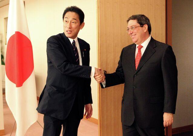 Japan's Forein Minister Fumio Kishida, left, greets his Cuba's counterpart Bruno Rodriguez Parrilla