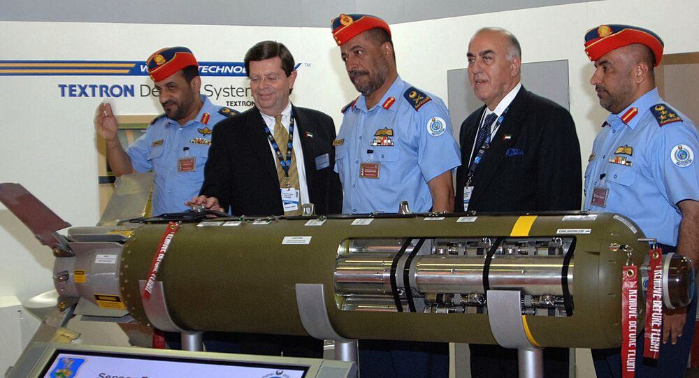 Thomas Harrington, vice president of US Textron Defense Systems, (2nd L) presents a sensor fuzed weapon CBU-105 to Emirati Major General Mohammed bin Swaidan Said al-Qamzi, Commander of UAE's Air Force and Air Defence, (3rd L)