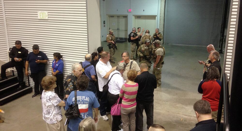 People are sequestered by members of the Garland Police Department inside the Curtis Culwell Center, Sunday, May 3, 2015, in Garland, Texas.