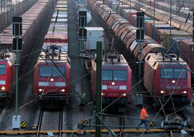 File photo of a worker passing parked locomotives in Europe's biggest marshalling yard in Maschen, near the northern German town of Hamburg, March 10, 2011.