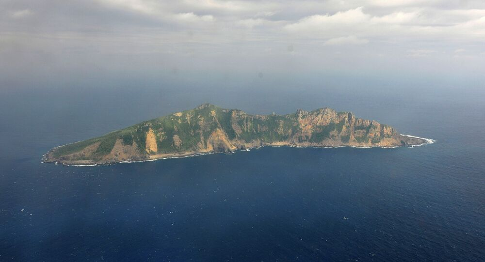 One of the small islands in the East China Sea known as Senkaku in Japanese and Diaoyu in Chinese is seen from a Chinese marine surveillance plane