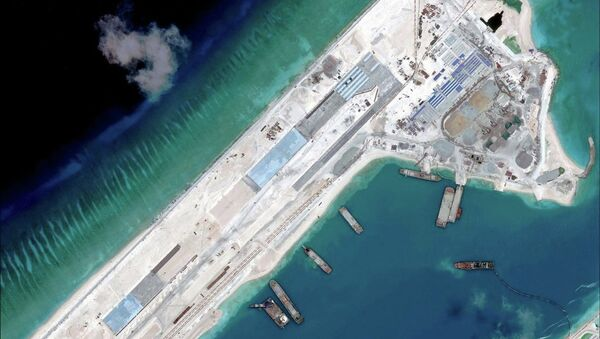 Airstrip construction on the Fiery Cross Reef in the South China Sea is pictured in this April 2, 2015 handout satellite image obtained by Reuters on April 16, 2015 - Sputnik International