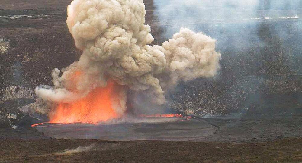 In this May 3, 2015 photo provided by U.S. Geological Survey Hawaiian Volcano Observatory, smoke and lava explode from Kilauea volcano on Hawaii's Big Island