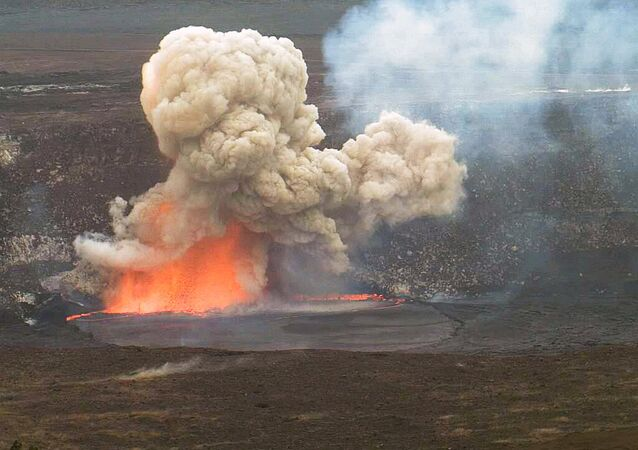 In this May 3, 2015 photo provided by U.S. Geological Survey Hawaiian Volcano Observatory, smoke and lava explode from Kilauea volcano on Hawaii's Big Island