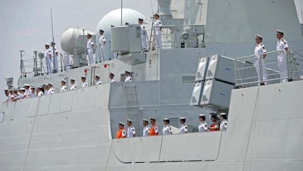Crew members of Chinese Navy stand guard on the deck of Chinese navy ship Wei Fang - Sputnik International