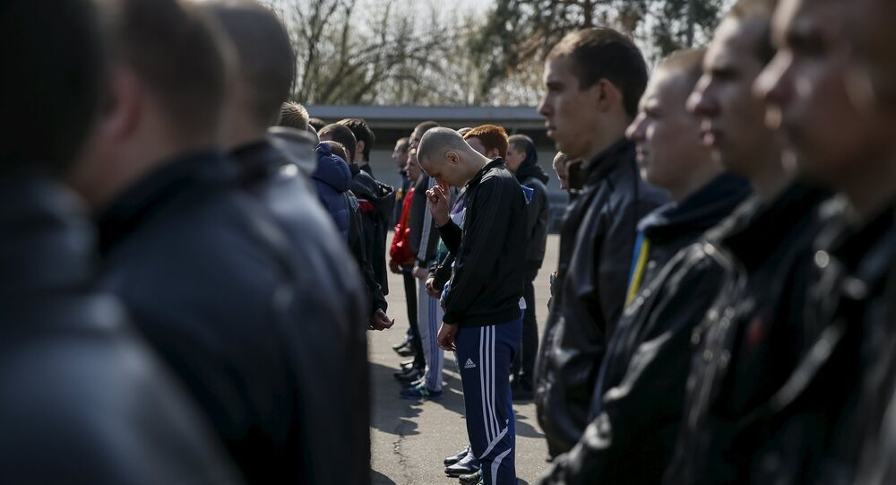 Ukrainian conscripts line up during a ceremony marking the first batch of conscripts in the Ukrainian army at the parade square of a recruitment office in Kiev, April 16, 2015.