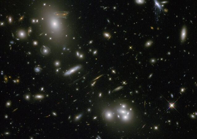 An image of a galaxy cluster taken by the Hubble Space Telescope