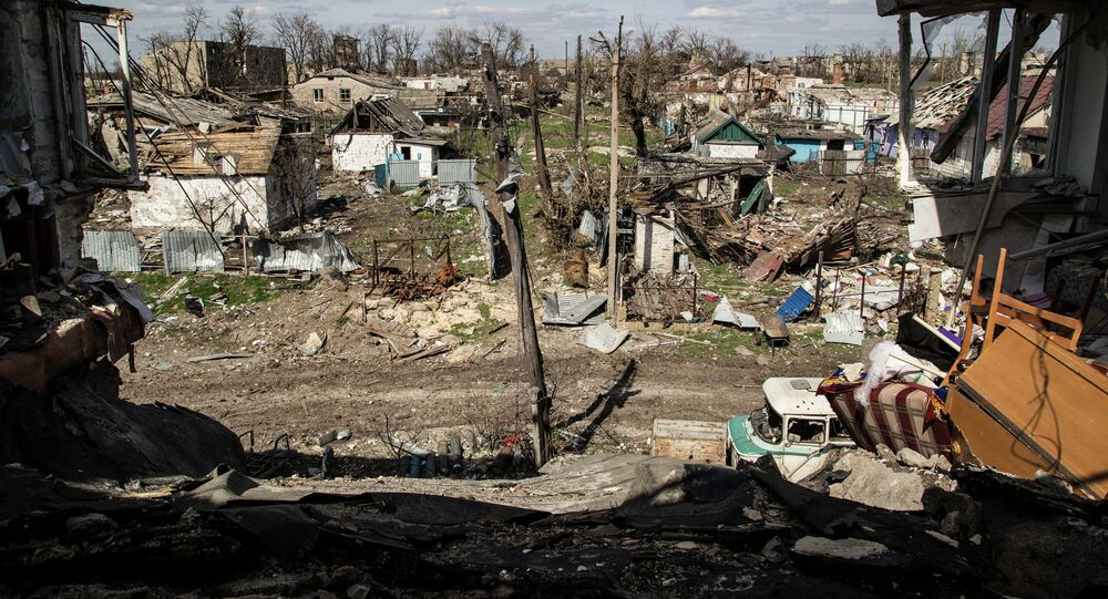 A picture taken on April 23, 2015 shows residential houses destroyed after shelling in the village of Peski, near Donetsk, on April 23, 2015