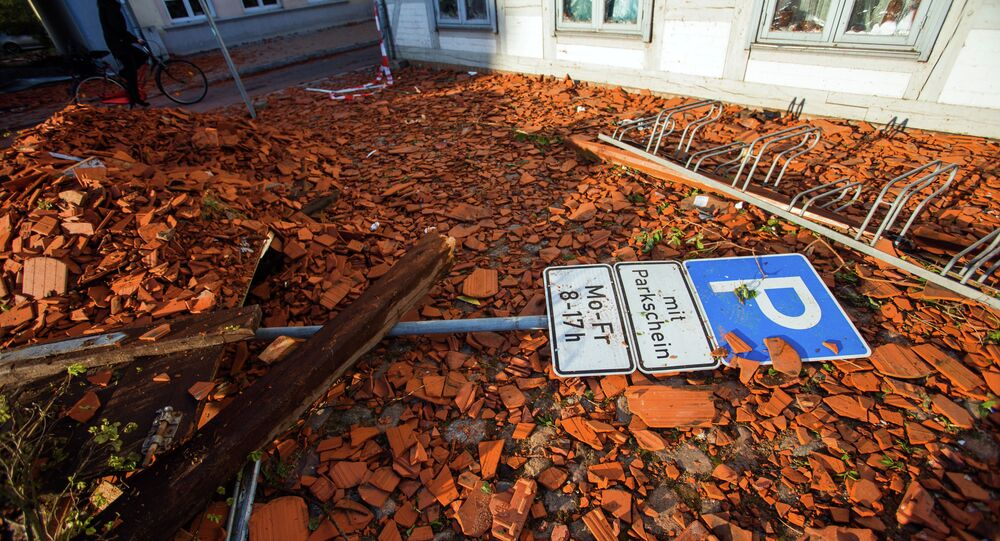 A parking sign lays amidst tiles blown away from roofs by a tornado on a street in Buetzow, northeastern Germany, on May 6, 2015.