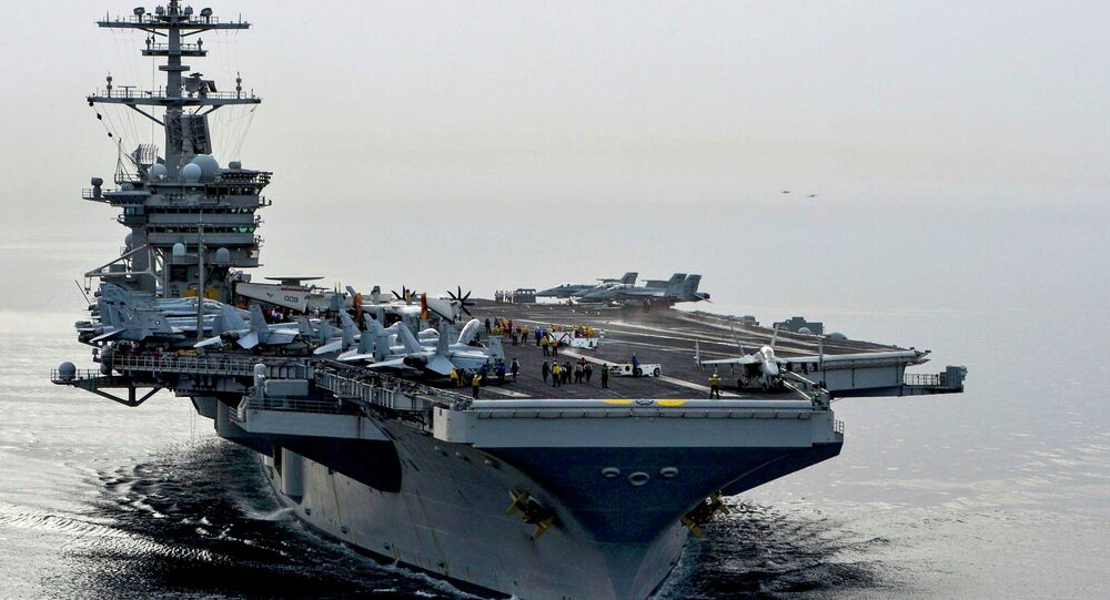 The aircraft carrier USS Theodore Roosevelt (CVN 71) sails in the Arabian Sea, in this U.S. Navy