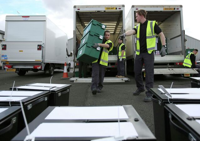 City council workers assemble ballot boxes for distribution ahead of general election, in Glasgow, Scotland, Britain, May 6, 2015