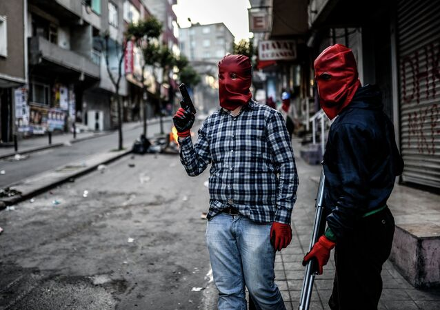 Militants of the Revolutionary People's Liberation Party-Front (DHKP-C) stand in the street with guns during a demonstration after the funeral of a protester killed in a recent protest