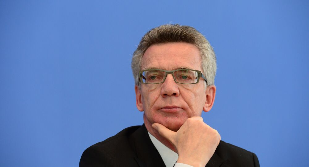 German Interior Minister Thomas de Maiziere attends a press conference to present politically-motivated crime rate in Germany