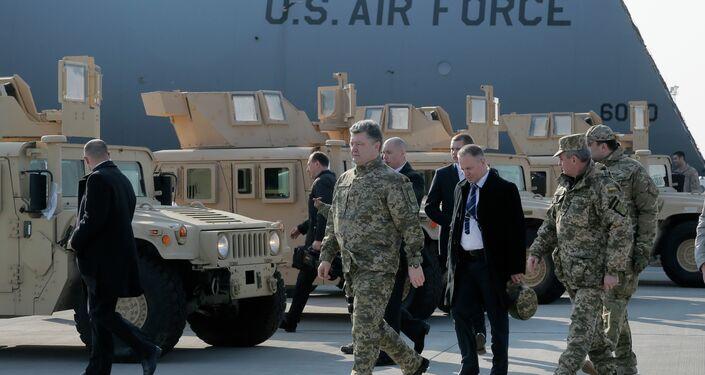 Ukraine's President Petro Poroshenko passes by U.S. armored Humvees in Boryspil Airport, Kiev, Ukraine