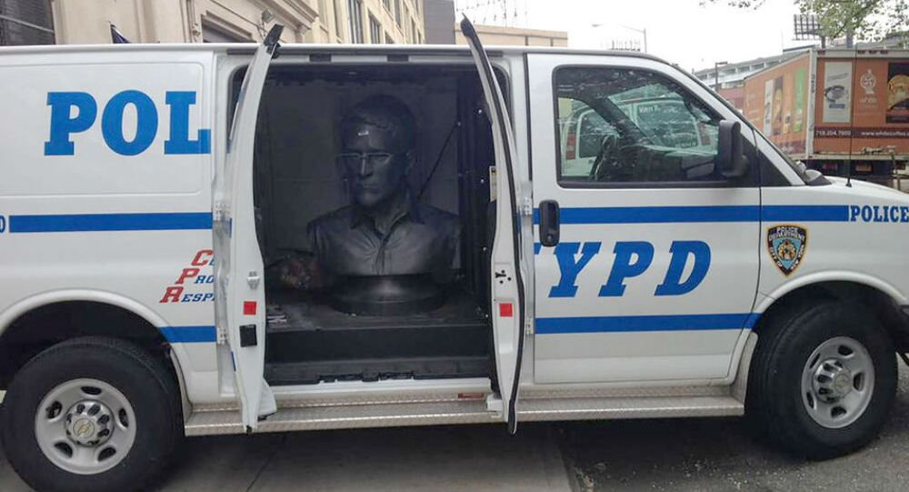 A sculpture of NSA whistleblower Edward Snowden is seen in the back of an NYPD van on May 6, 2015.