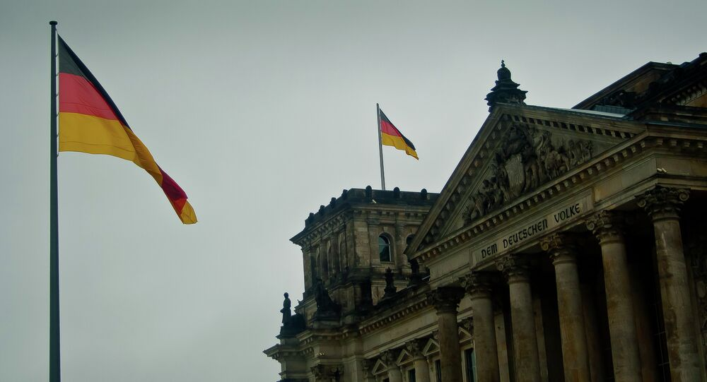 Germany flags fly at the Bundestag.