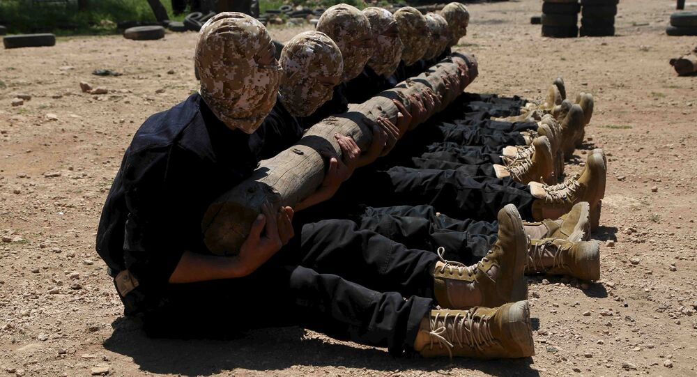 Rebel fighters from 'the First Regiment', part of the Free Syrian Army, hold a log as they participate in a military training in the western countryside of Aleppo May 4, 2015