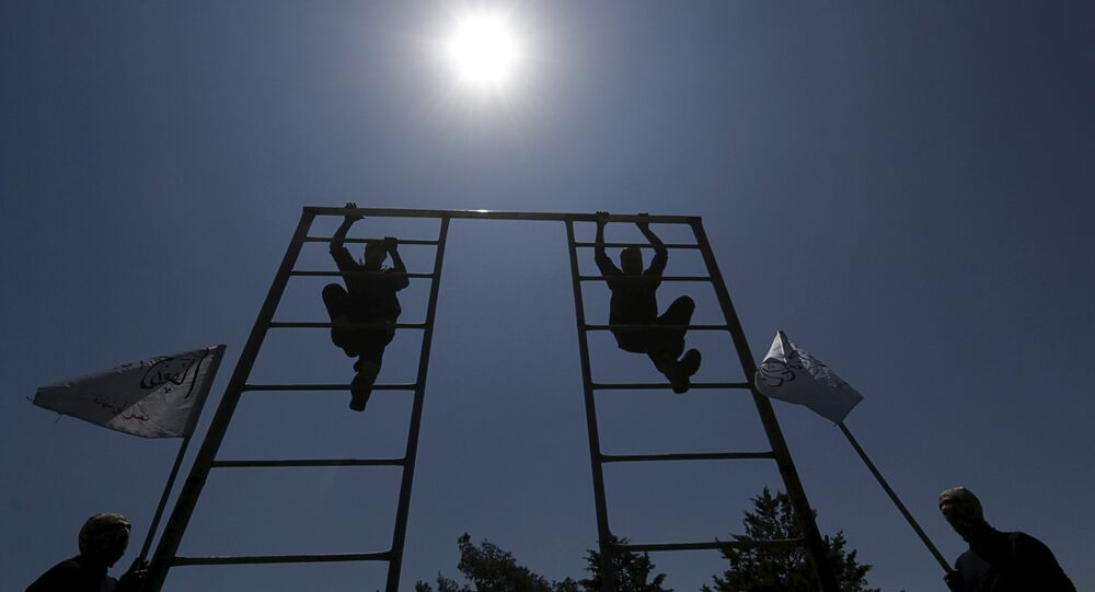 Rebel fighters from 'the First Regiment', part of the Free Syrian Army, climb on a bar as they participate in a military training in the western countryside of Aleppo May 4, 2015