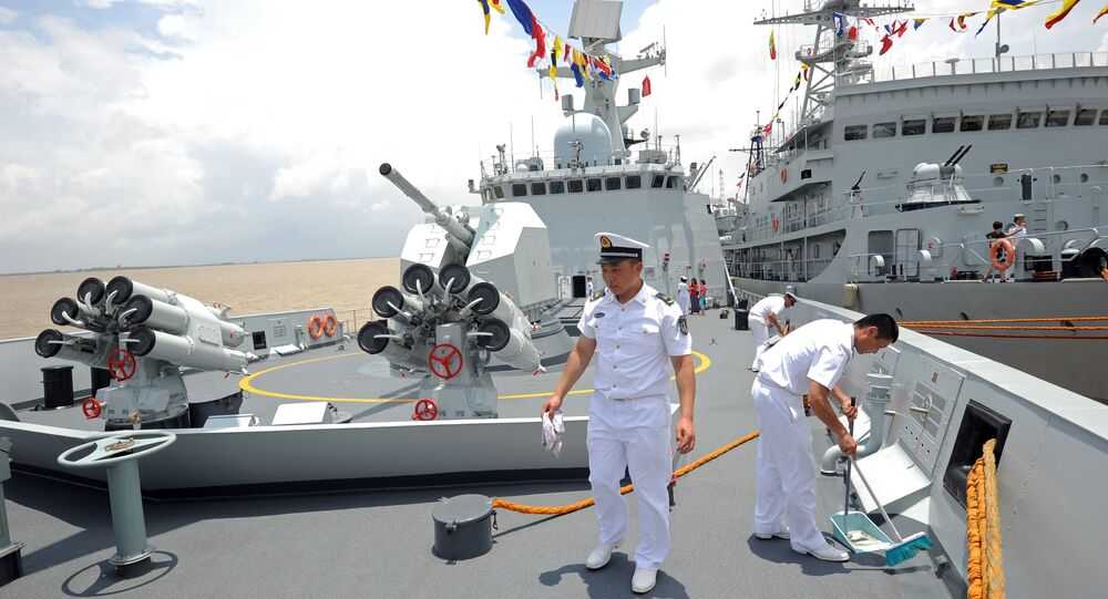 Crew members work on the Chinese Navy ship Wei Fang