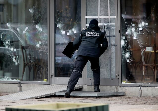 A police investigator works at the scene of Saturday's shooting at a free speech event in Copenhagen