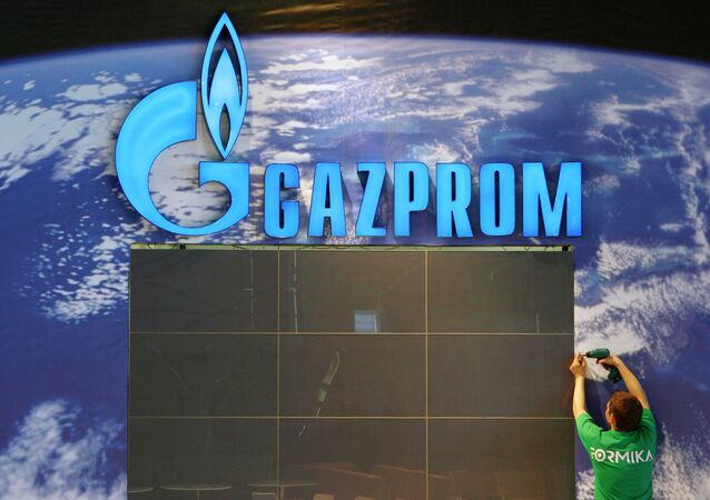 An employee assembles parts at the booth of Russian company Gazprom