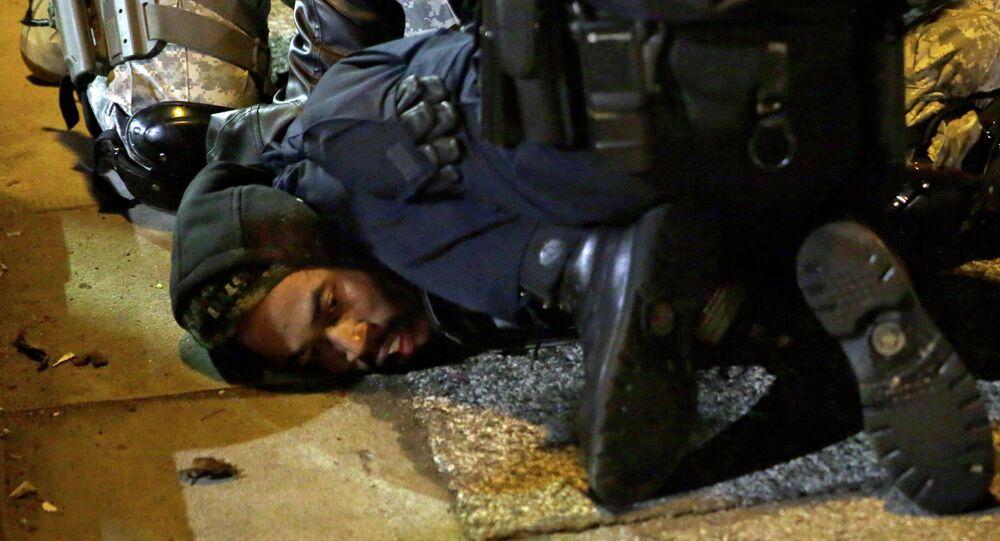 A protester is taken into custody in Ferguson, Mo.