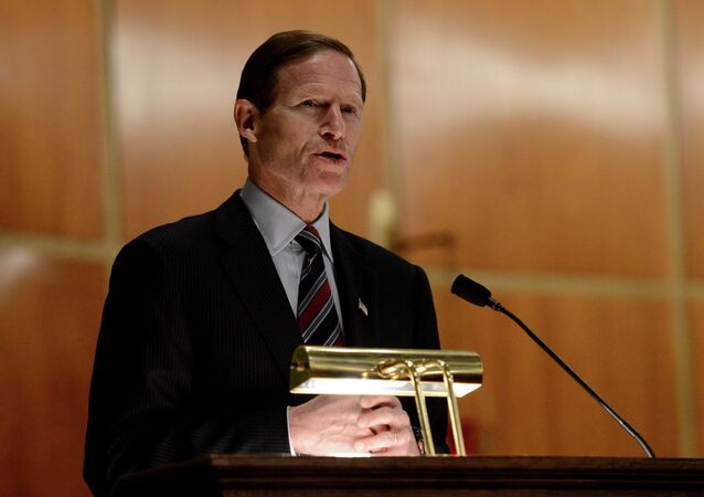 US Sen. Richard Blumenthal speaks to mourners at a vigil service for victims of the Sandy Hook Elementary School shooting, at the St. Rose of Lima Roman Catholic Church in Newtown, Conn.
