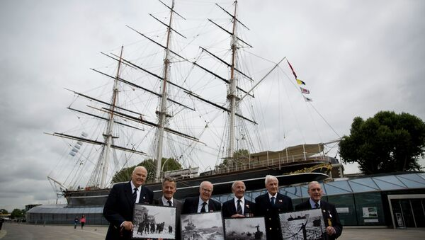 Veterans who served in Britain's Merchant Navy pose with a selection of Royal Mail Merchant Navy stamps during a launch at the Cutty Sark clipper vessel in London, Wednesday, Sept. 18, 2013 - Sputnik International