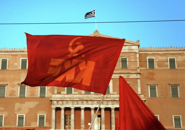 A Greek Communist Party flag waves in front of the Parliament in Athens during an protest against any military action by the U.S. and its allies against Syria, Thursday Aug. 29, 2013