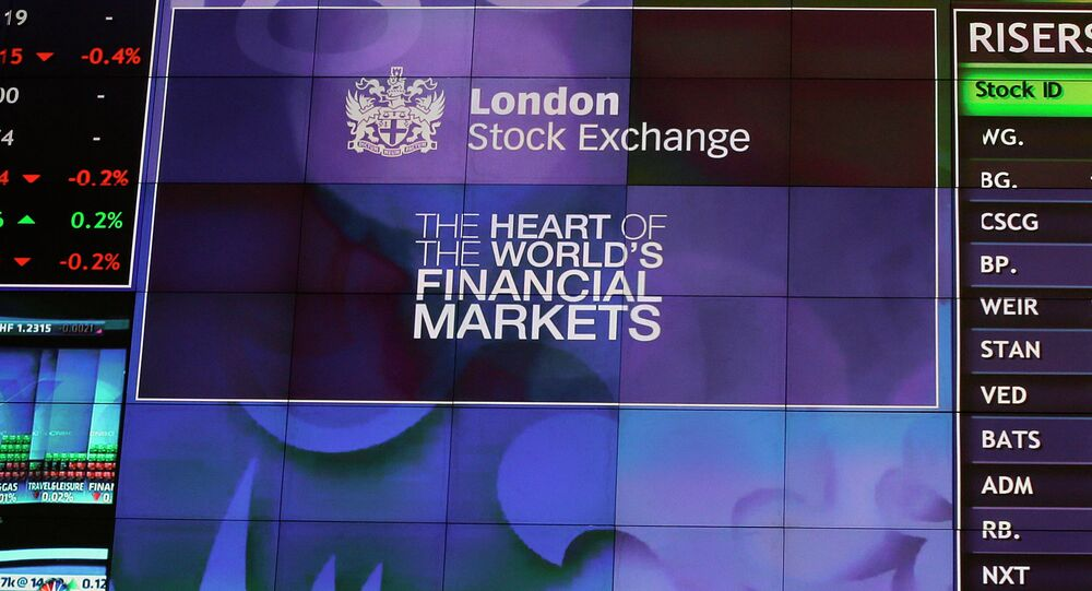 The main video board seen inside the entrance to the official offices for the London Stock Exchange is seen just after the start of trading in London