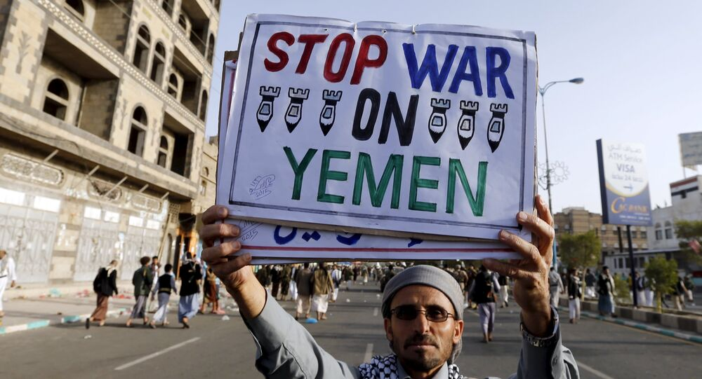 A follower of the Houthi group holds up a sign at the site of a demonstration against the air strikes by the Saudi-led coalition in Sanaa April 27, 2015