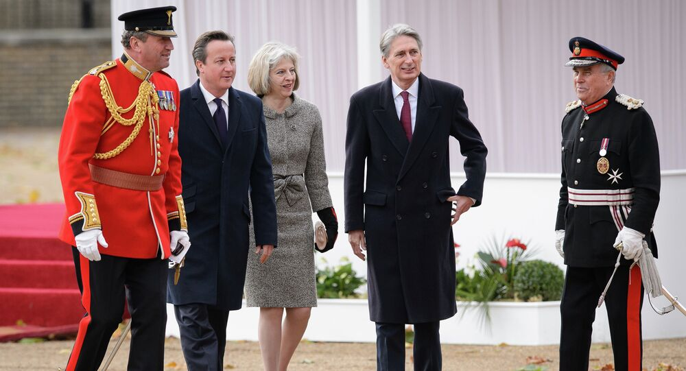 British Prime Minister David Cameron (2L), Home Secretary Theresa May (C) and Foreign Secretary Philip Hammond (2R)