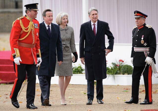 British Prime Minister David Cameron (2L), Home Secretary Theresa May (C) and Foreign Secretary Philip Hammond (2R)