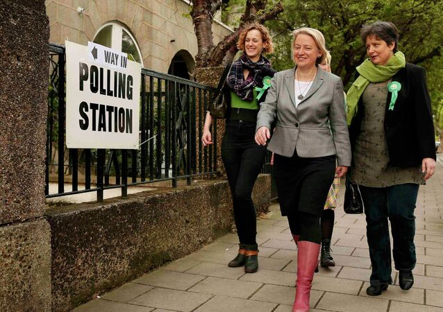 Natalie Bennett (C), the leader of the Green Party arrives to vote at a polling station in London, Britain, May 7, 2015