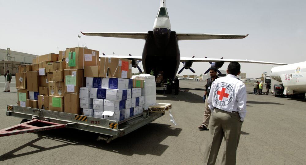 Emergency medical aid from the International Committee of the Red Cross is unloaded from a plane at the international airport in Sanaa on April 10, 2015