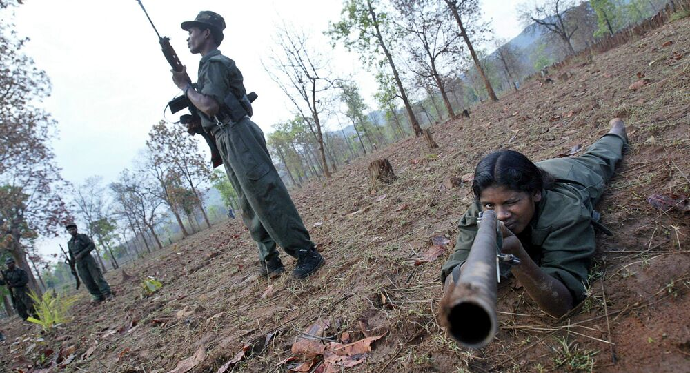 Maoist rebels exercise at a temporary base in the Abujh Marh forests, in the central Indian state of Chattisgarh
