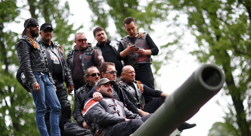 Members of the motorcycle group called Night Wolves coming from Russia, Macedonia and Bulgaria pose for a picture on top of a Red Army tank at the German-Russian museum Berlin-Karlshorst in Berlin, Germany, May 8, 2015