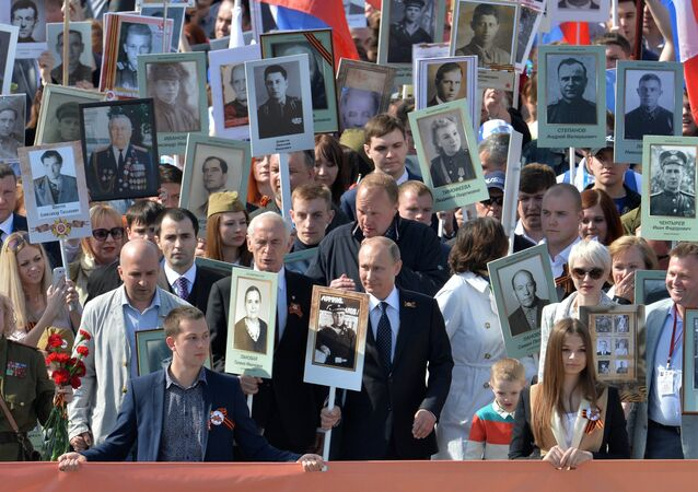 The president of the Russian Federation Vladimir Putin (in the center) during procession of Regional patriotic public organization Immortal Regiment Moscow along the Red Square