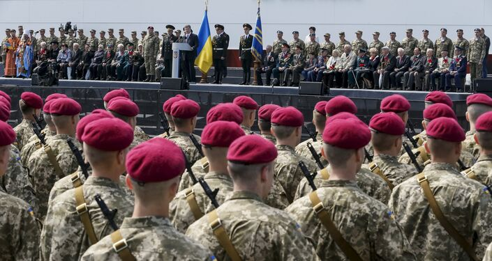 Ukrainian President Petro Poroshenko (top C) addresses recruits from the presidential regiment as war veterans look on during Victory Day celebrations in the Museum of the Great Patriotic War in Kiev, Ukraine May 9, 2015